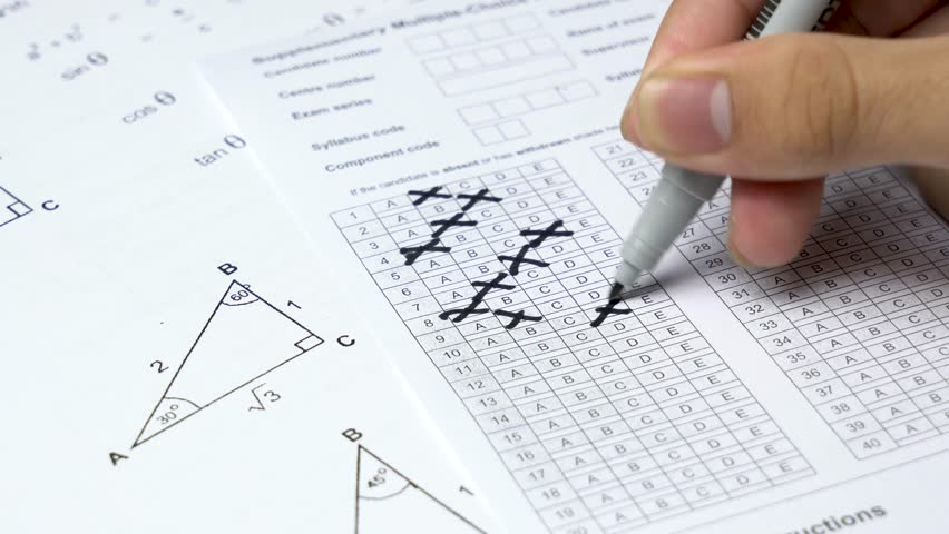 Angry young boy student squeezing answer sheet during take examination test for protest. Student protest exam. | Shutterstock HD Video #32346307