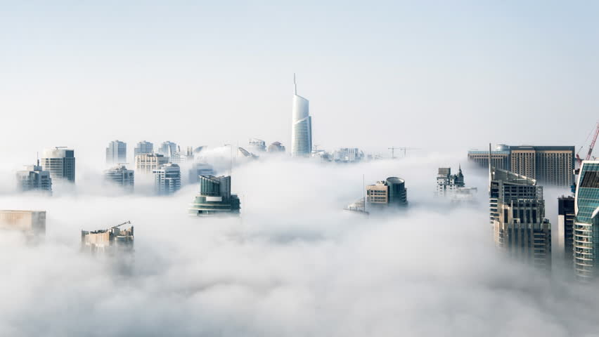 Cinemagraph of skyscrapers above the clouds in Hong Kong with clouds rolling through city in