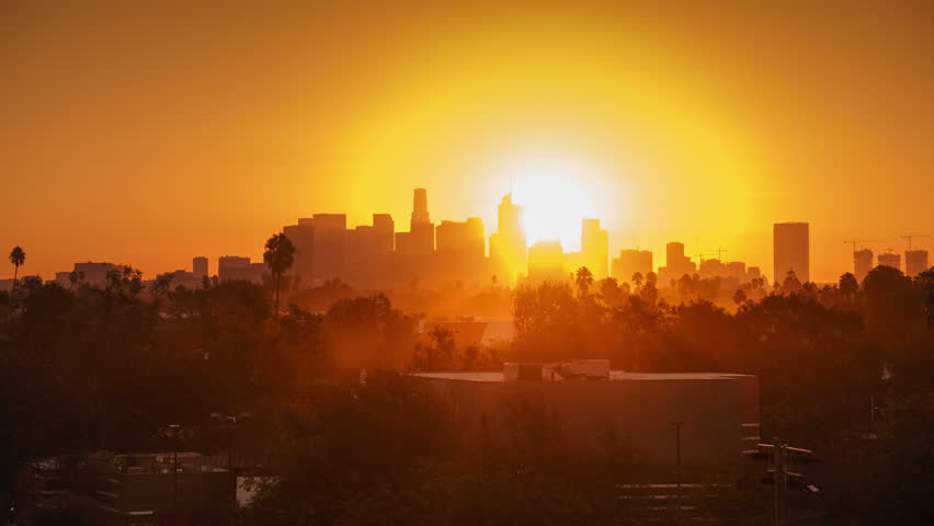 Sunrise over city, closeup on modern downtown Los Angeles skyline buildings silhouettes. 4K UHD timelapse. #32355847