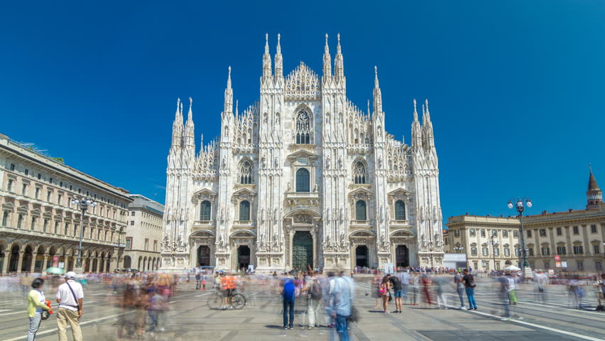 The Duomo cathedral timelapse hyperlapse. Front view with people walking on square. The Gothic cathedral took nearly six centuries to complete. It is the fifth largest cathedral in the world and the