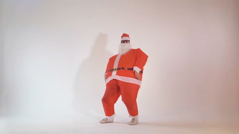 Cheerful Santa Claus partying on Christmas eve making funny dancing movements. 4K.
