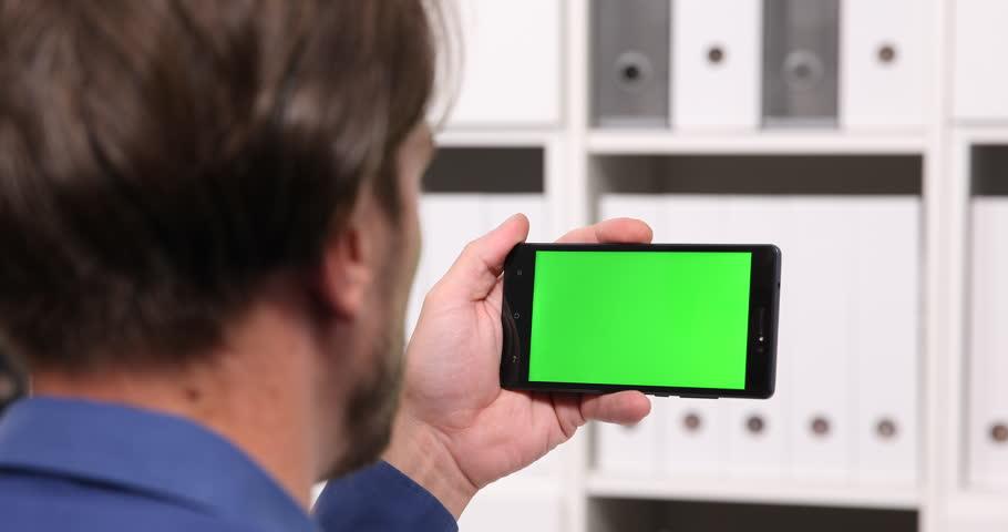 Man Watching on Mobile Phone Movie Internet Media Online Green Screen Background | Shutterstock HD Video #32382787