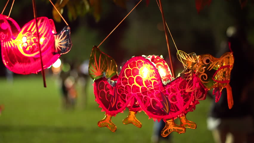 Malaysia Traditional Chinese Dragon Shape Lantern Hanging On A Tree During Mid-Autumn Festival With Blurry Background