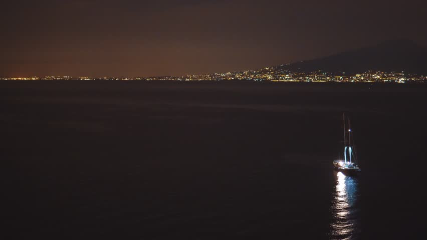 Night scene of Napoli, Torre, Pompei, the pier with lots of yachts, a corner of the cityscape on a summer night, Italy, travel concept design, city lights