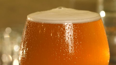 Image result for ice cold beer with perspiration trickling down the glass
