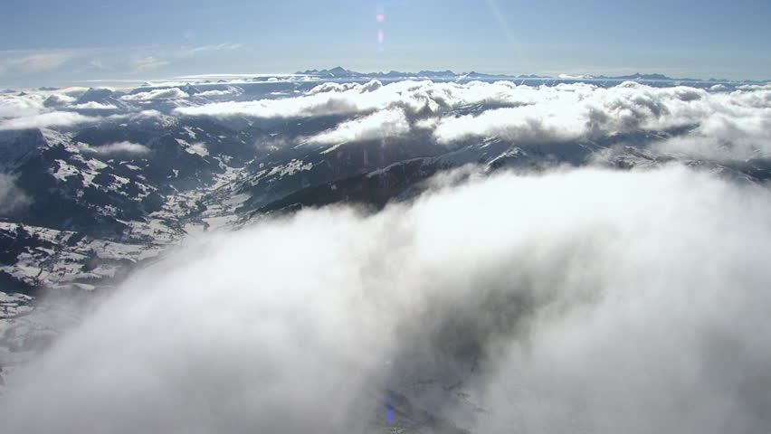 WS AERIAL Snowy mountains with clouds / Kitzbuehel, Tyrol, Austria | Shutterstock HD Video #32564677