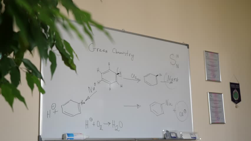 Hand-drawing chemical formulas. Organic chemical formulas on a white chalkboard. Blackboard with chemical formulas