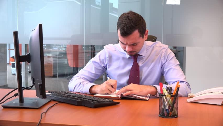 Business man in the office writing agenda schedule painful headache overworked | Shutterstock HD Video #32566807