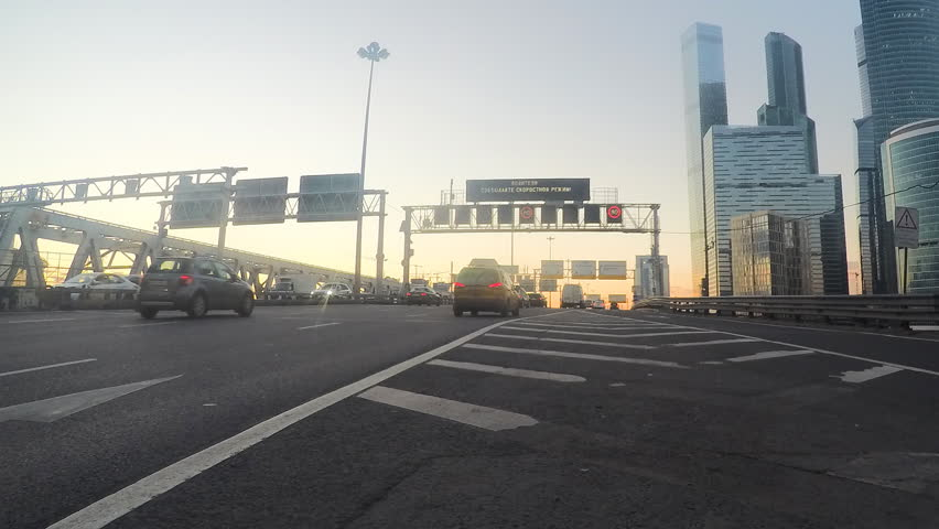 Car traffic on the road near glass skyscrapers timelapse | Shutterstock HD Video #32571187