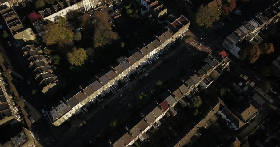 Aerial drone footage top down perspective over residential buildings in the north of london, UK, on a bright sunny day.  Excellent establishing shot.