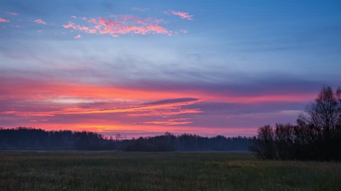 4k time-lapse of beautiful sunrise sky over autumnal meadow. 3840x2160, 24fps