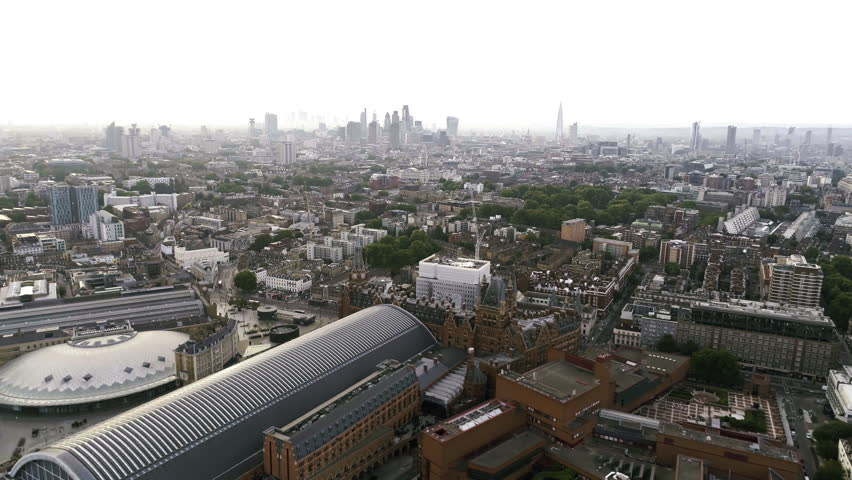 Aerial View Iconic Towers Skyscrapers and King's Cross St Pancras International Station around Euston in City Central Town of London England 4K