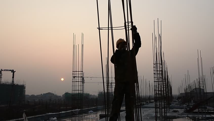 Worker working with concrete reinforce iron near sunset | Shutterstock HD Video #3259387