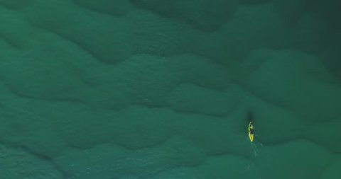 Canoe navigating through beautiful turquoise water. Aerial view of a canoe, kayak in the water