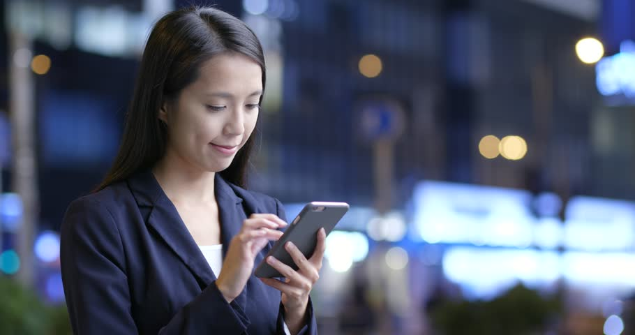 Businesswoman use of cellphone in city | Shutterstock HD Video #32643997