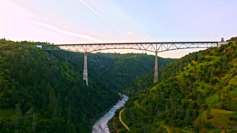 Cinematic aerial of The Foresthill, Auburn-Foresthill or Auburn road bridge crossing over the North Fork American River in Placer County and the Sierra Nevada foothills, in eastern California.