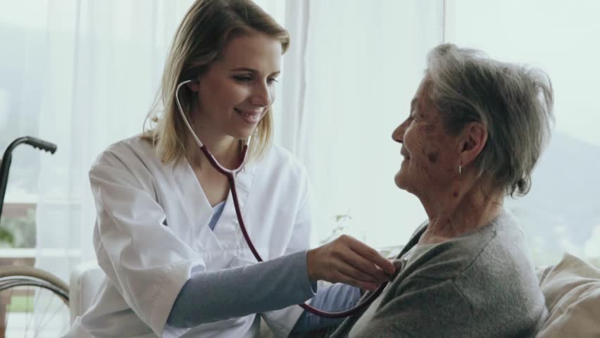 Health visitor and a senior woman during home visit. A female nurse or a doctor examining a woman. Slow motion. | Shutterstock HD Video #32667007