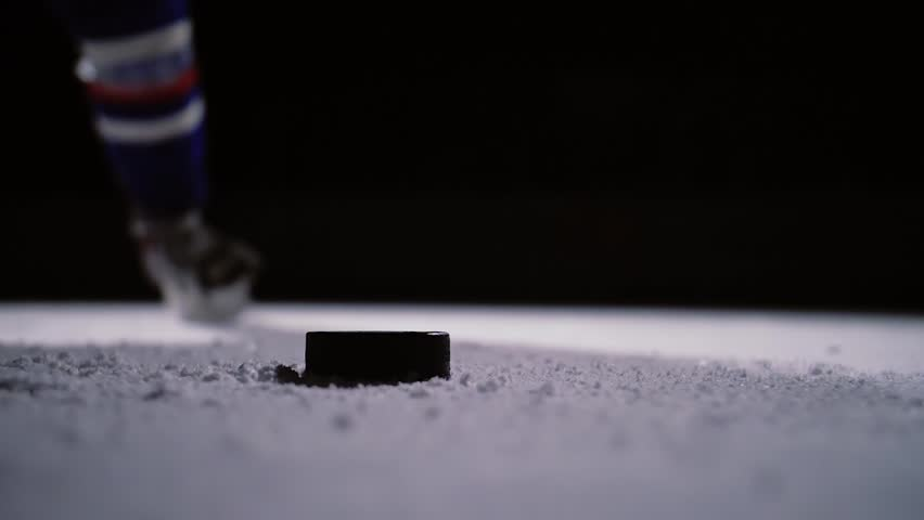 Professional hockey player produces a shot on goal at ice arena | Shutterstock HD Video #32674537