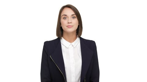portrait of caucasian short-haired woman with beautiful blue eyes wearing business suit posing at camera with kind look smiling over white background in studio. Concept of emotions