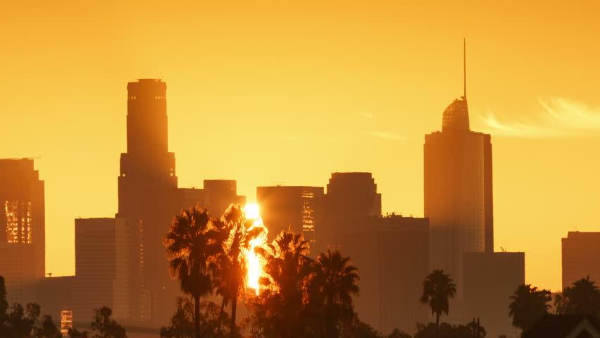 Sunrise sun rising over downtown Los Angeles city skyline. 4K UHD timelapse.