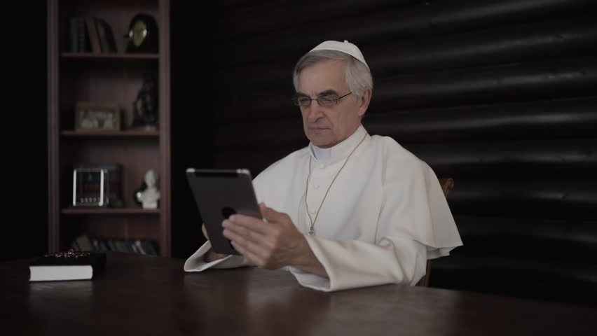 Pope uses internet on tablet pc in his office in Vatican. 4K