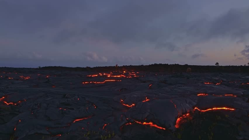 Dusk night sunset over lava Dusk sunset Glowing Hot flow from Kilauea Active Volcano Puu Oo Vent Active Volcano Magma