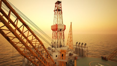 Drone Fly-through shot of oil rig on the open sea, during sunset.