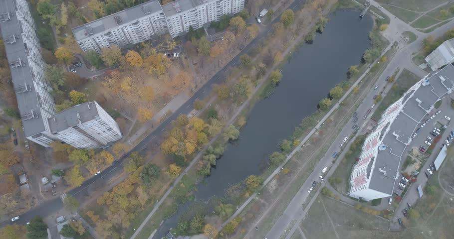 Drone shot of concrete jungle of living area in Kharkiv, Ukraine. The shot is revealing (tilt) neverending amount of houses in the city of Kharkiv, Ukraine during the autumn season.
