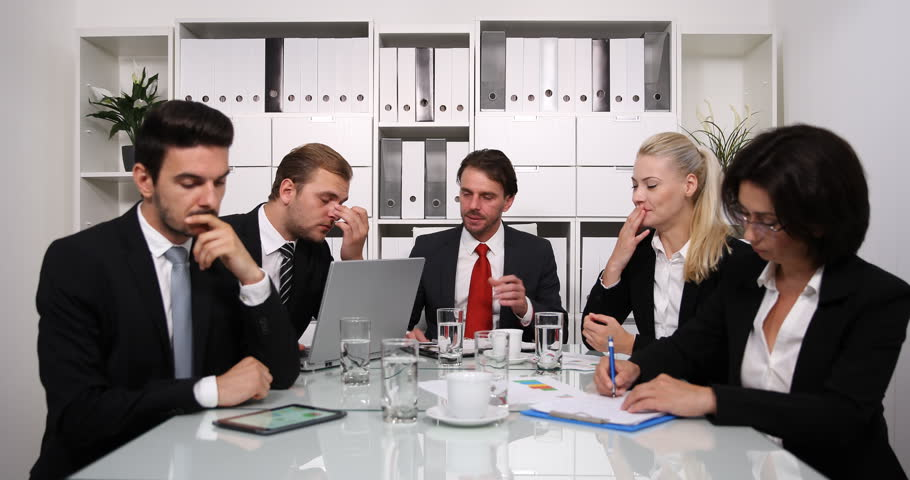 Exhausted Team of Business People Loose Attention in Boardroom Overworked Group   Shutterstock HD Video #32807077