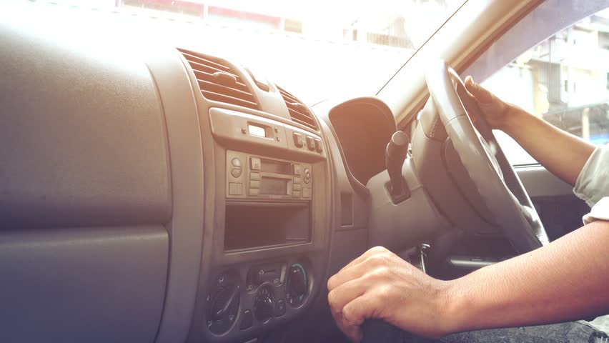 Man's hand is driving car at sunset   Shutterstock HD Video #32826067