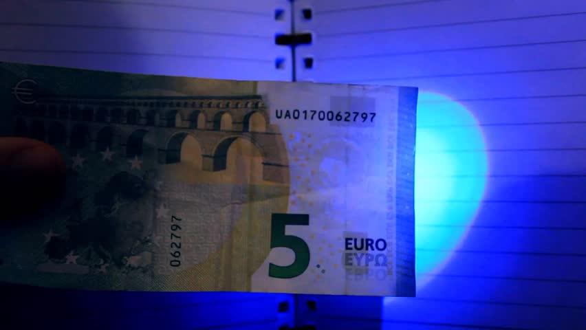 Money detector - UV light - fluorescent gliders | Shutterstock HD Video #32840596