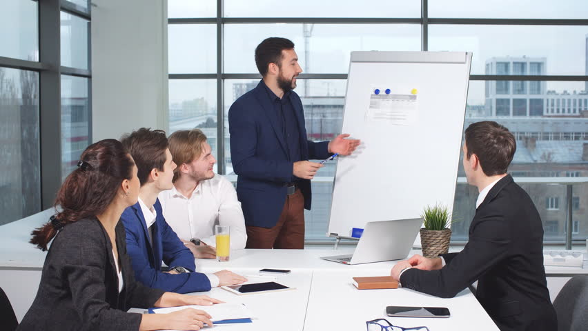Boss showing his employees a document. | Shutterstock HD Video #32855611