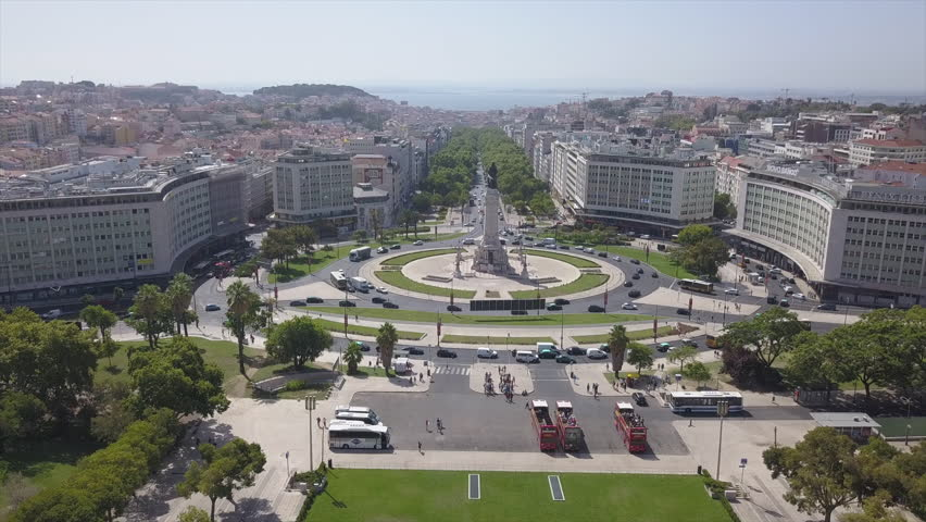 sunny day lisbon city marquess of pombal square aerial park panorama 4k portugal