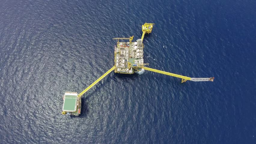 Bird eye view of offshore oil and gas central processing platform which comprised of central facility, accommodation area, flare and remote platform that produce raw product, power and energy business