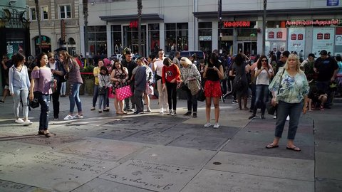 Los Angeles, California, USA - November 18, 2017:  People and tourists  walking on the Walk of Fame street