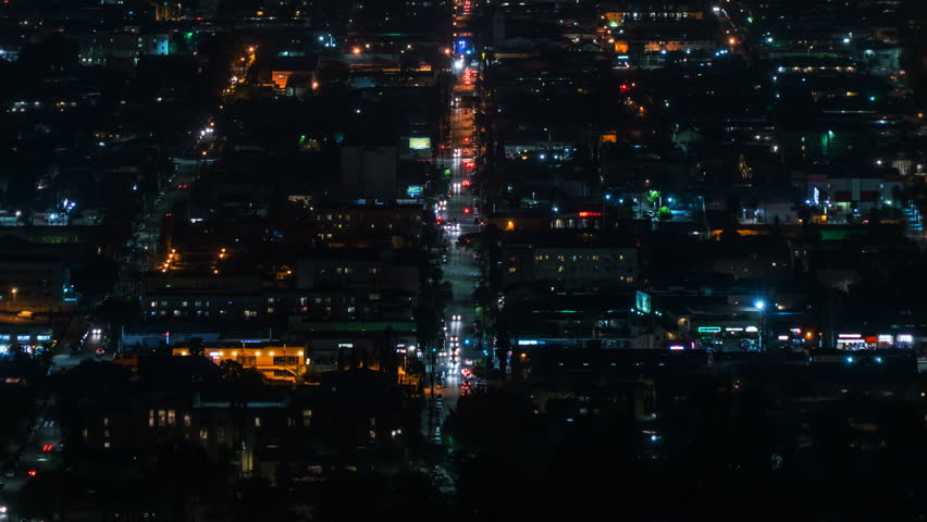 Beautiful view of Los Angeles from Griffith Observatory. Shinning city lights and traffic. California. Timelapse. Zoom out. | Shutterstock HD Video #32946592