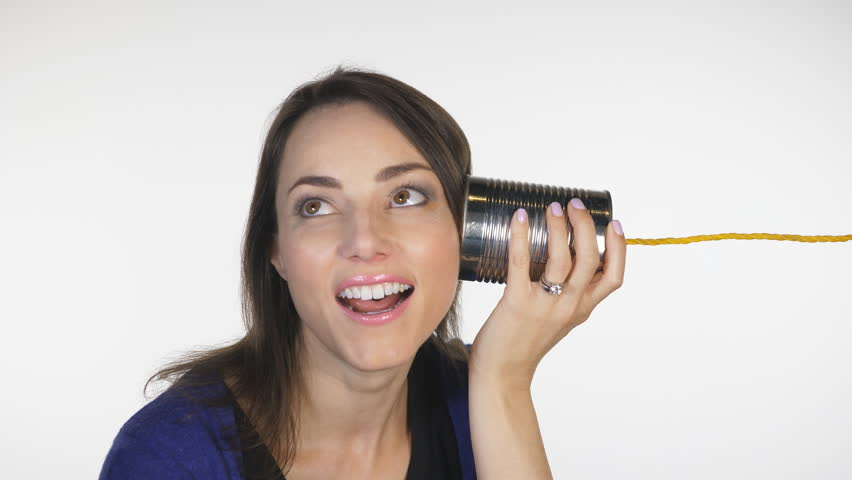 Attractive woman has conversation on tin can telephone. Obsolete technology.  | Shutterstock HD Video #32958010