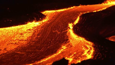 River of lava Night Glowing Hot flow from Kilauea Active Volcano Puu Oo Vent Active Volcano Magma