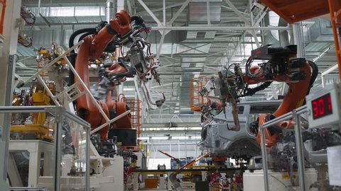 BELARUS, BORISOV - OCTOBER 19, 2017: Automobile plant, robot equipment, welding process and assembly line of cars, modern production, October 19 in Belarus.