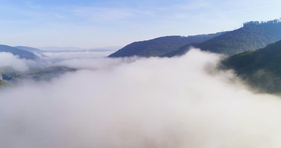 Aerial View. Flying over the high mountains in beautiful clouds . Aerial camera shot. Air clouds. 4k | Shutterstock HD Video #33016567