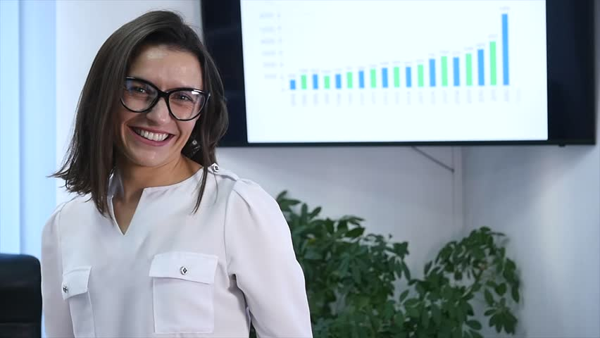 Confident mature businesswoman standing in office. Female manager in office looking at camera and smiling. slow motion | Shutterstock HD Video #33047257