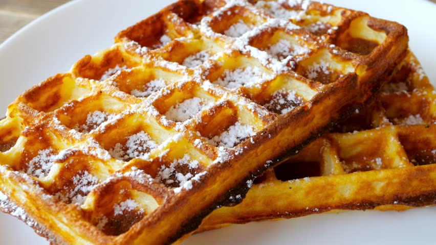 Waffle with maple syrup topping and sugar powder, delicious sweet dessert. #33074107