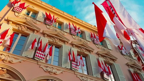 Many National Flags of Monaco on the Facade of a Building During The National Day of Monaco, The Sovereign Prince's Day (Prince's Holiday) is Currently Annually Celebrated on 19 November  - 4K Video