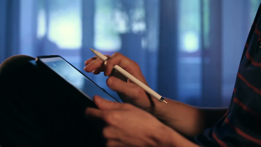 Closeup shot of designer's hand scaling and drawing a sketch on tablet using stylus at home.  | Shutterstock HD Video #33082783