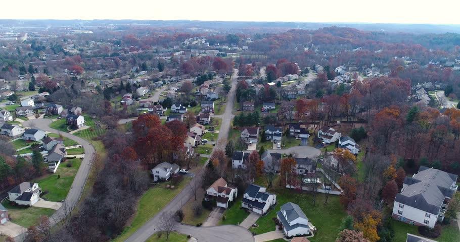 A daytime late Autumn aerial establishing shot of a typical Western Pennsylvania neighborhood. Pittsburgh suburb.