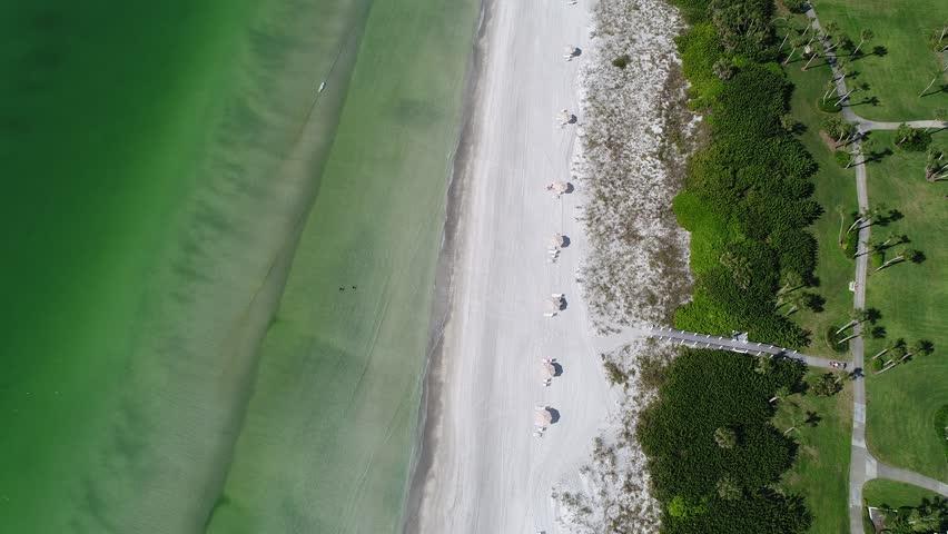 A drone flies over a beach in Longboat Key near Sarasota, Florida.