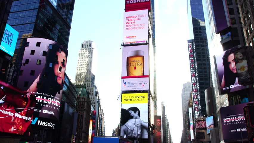 New York City, NY - SEPTEMBER 17, 2017:  Drone shot of Times Square advertisement LED screens and billboards in NYC. Busy tourist street Times Square in Manhattan in NYC.