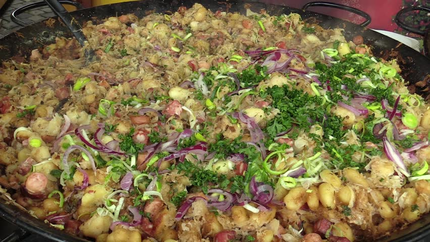 Slovak national specialty original halusky with brynza and cabbage, very healthy, tasty and nutritious for man, sale of Christmas markets in Olomouc, European Union | Shutterstock HD Video #33091528