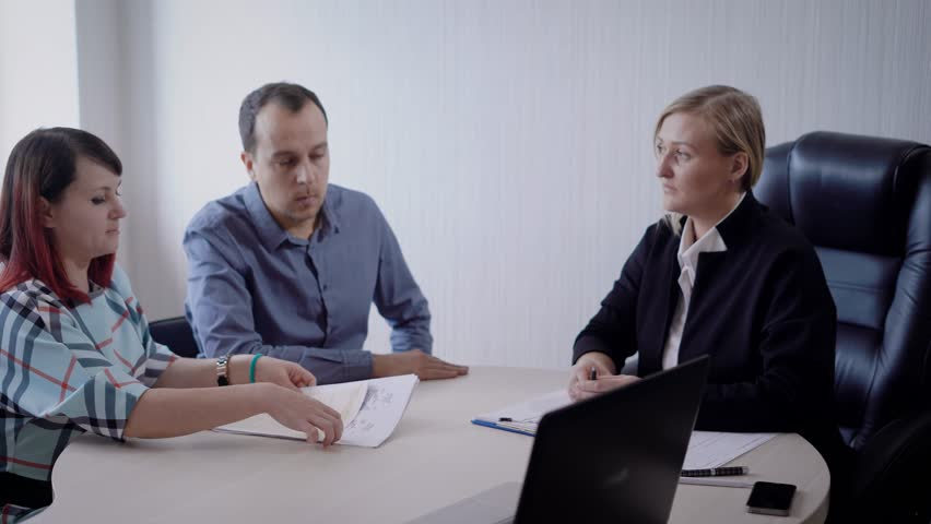 Married couple successfuly discussed all details with adviser. | Shutterstock HD Video #33104134