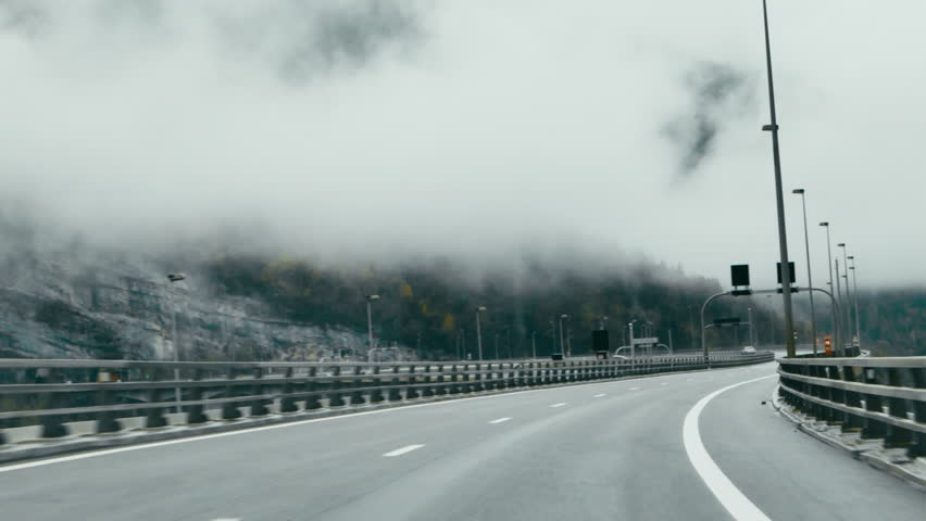 POV DRIVING PLATE Car driving on a scenic mountain highway, clouds flying low. 4K UHD   Shutterstock HD Video #33143137
